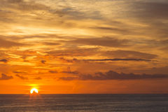 Sunrise Over the Ocean. A bright and colorful sunrise of the horizon of the ocean Royalty Free Stock Photography