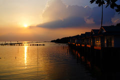 Sunrise over ocean bungalows on a cloudy day. In Thailand Royalty Free Stock Photography