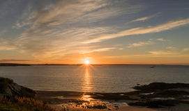 Sunrise over the ocean and coast of New Brunswick. The sun rises over the Atlantic and the Bay of Fundy in New Brunswick near Pocologan stock photo