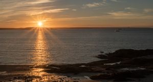 Sunrise over the ocean and coast of New Brunswick. The sun rises over the Atlantic and the Bay of Fundy in New Brunswick near Pocologan Royalty Free Stock Image