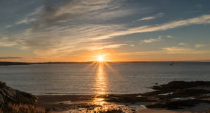 Sunrise over the ocean and coast of New Brunswick. The sun rises over the Atlantic and the Bay of Fundy in New Brunswick near Pocologan Royalty Free Stock Photography
