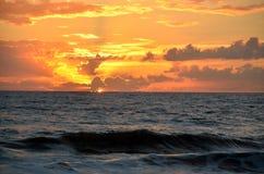 Sunrise over ocean, Florida, USA. Sunrise in orange skies over ocean waves off coastal Florida, USA Stock Photos