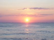 Panoramic view of sunrise on ocean with orange sky royalty free stock image