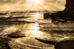 Sunrise over Ocean and Rays of Sunlight. With Waves Stock Photography