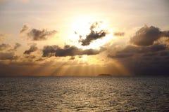 The sunrise over the ocean. Stock Photos