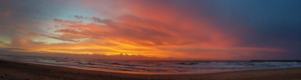 Sunrise. Over the ocean sitting on the beach Stock Photo