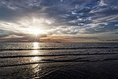 Sunrise Over OCean Sun Through Clouds Royalty Free Stock Photography
