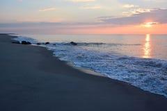 Sunrise Over Ocean. The sunrises over the ocean early in the morning Stock Photo