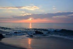 Sunrise Over Ocean. The sunrises over the ocean on a summer morning Stock Photo