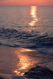 Sunrise Over Ocean. The sunrises over the ocean on a summer morning Stock Photography