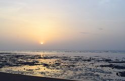 Sunrise over Ocean at time of Ebb. This is a photograph of rising sun over sea at time of ebb... The photograph is captured at Hathab beach, Gujarat, India Stock Images