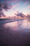 Sunrise over the Ocean, vertical photo. Colorful sunrise over Atlantic Ocean coast, Bavaro beach, Hispaniola Island. Dominican Republic, vertical coastal stock photography