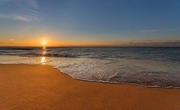 Sunrise over ocean waves. Sunrise light shining on ocean waves Stock Photos