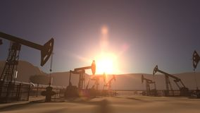 Sunrise over oil field with pumpjacks and pipeline. Sunrise over oil field with oil pump jacks and oil pipeline stock video footage