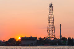 Sunrise over Oil refinery tower Stock Photo