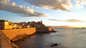 Sunrise over the old town of Antibes, France Stock Photography