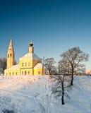Sunrise over orthodox church Stock Photos