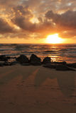 Sunrise over the Pacific. The sunrise over on the Pacific Ocean horizon in Lihue, Kauai in Hawaii Stock Photo