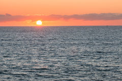 Sunrise over Pacific ocean Stock Images