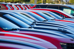 Sunrise over a packed colorful parking lot. Sunrise at a jam packed parking sales lot with many rows of colorful automobiles Stock Photography