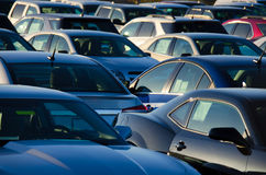 Sunrise over a packed parking sales lot. Sunrise at a jam packed parking sales lot with many rows of automobiles Royalty Free Stock Images