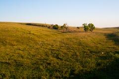 Sunrise over the Pasture. The sun rises over a pasture in the Nebraska sandhills Stock Images