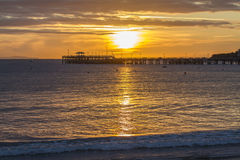 Sunrise over pier in bay Royalty Free Stock Photography