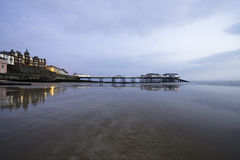 Sunrise over the Pier of Cromer Stock Images