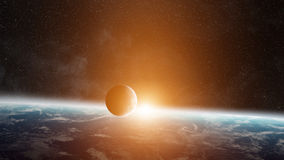 Sunrise over planet Earth in space Royalty Free Stock Images