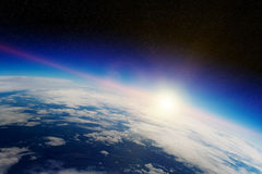 Sunrise over planet Earth in space Stock Photos