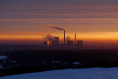 Sunrise over the plant. Power plant in the rays of the rising sun Royalty Free Stock Photos