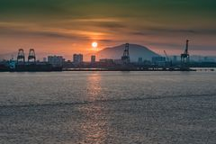 Sunrise over the port of Penang Malaysia. Sunrise from the sea in the port of Penang and in the background the buildings of the city Malaysia Royalty Free Stock Images