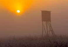 Sunrise over raised hide. Beautiful sunrise over foggy meadow with raised hide. Tranquil rural scene photographed with full frame camera Stock Photography