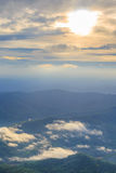 Sunrise over the range of mountains. Sunrise over the mountain range with clouds Royalty Free Stock Images