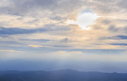 Sunrise over the range of mountains. Sunrise over the mountain range with clouds Royalty Free Stock Image