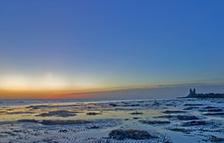 Sunrise over Reculver. Beach in Kent England Stock Photos