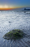 Sunrise over Reculver. Beach in Kent England Stock Image