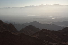 Sunrise over Red sea. Early morning in ancient mountains of Sinai desert. Sunrise over Red sea Stock Photo
