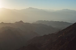 Sunrise over Red sea. Early morning in ancient mountains of Sinai desert. Sunrise over Red sea Royalty Free Stock Photos
