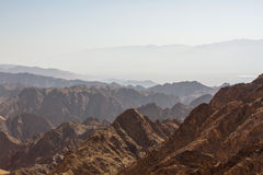 Sunrise over Red sea. Early morning in ancient mountains of Sinai desert. Sunrise over Red sea Stock Images