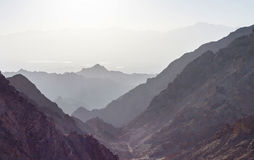Sunrise over Red sea. Early morning in ancient mountains of Sinai desert. Sunrise over Red sea Royalty Free Stock Photo
