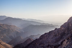 Sunrise over Red sea. Early morning in ancient mountains of Sinai desert. Sunrise over Red sea Royalty Free Stock Images