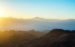 Sunrise over Red sea. Early morning in ancient mountains of Sinai desert. Sunrise over Red sea Stock Photos