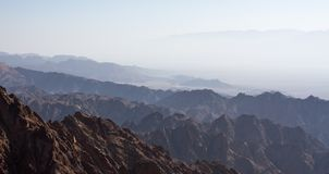 Sunrise over Red sea. Early morning in ancient mountains of Sinai desert. Sunrise over Red sea Stock Image