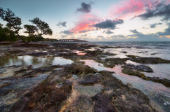 Sunrise over reef island. Stock Images