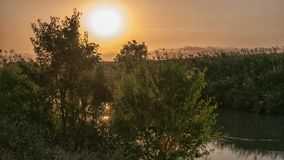 Sunrise over the river stock footage
