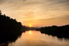 Sunrise. Over a river in Candolim, Goa India Stock Photography