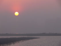 Sunrise over river marsh Stock Image