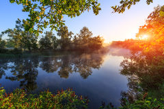 Sunrise over river with morning fog Stock Photography