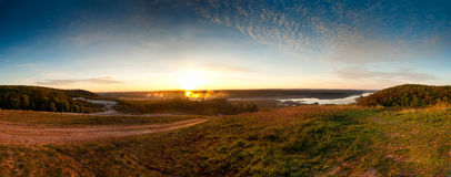 Sunrise over the river. Panorama a landscape sunrise over the river Royalty Free Stock Image